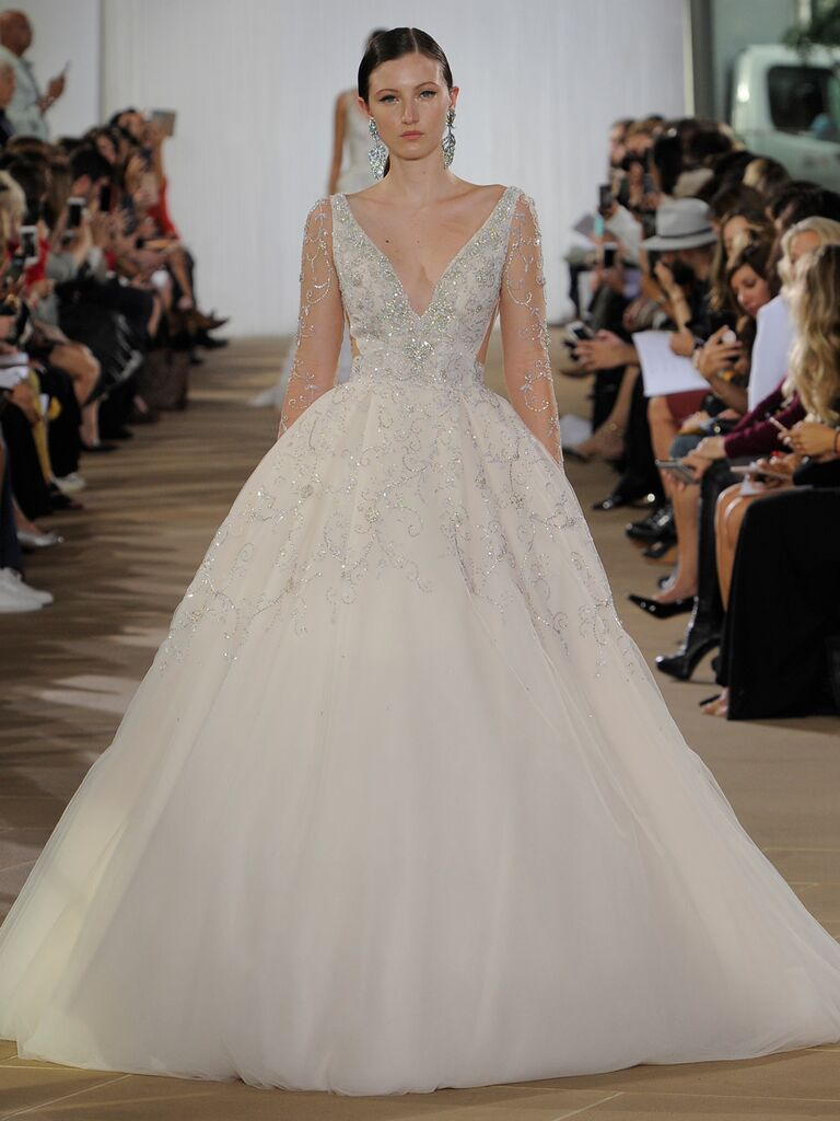 Ines Di Santo Fall 2019 wedding dress with a tulle ball skirt, embellished bodice and sheer long sleeves