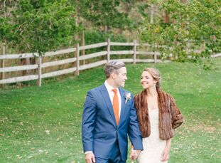 Maureen and Hank used a seasonal color scheme of burnt orange and navy for their rustic-chic farm wedding.