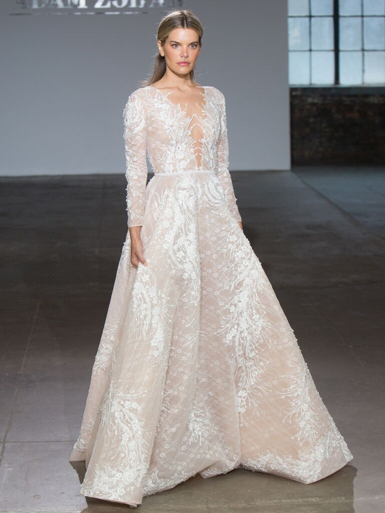 Adam Zohar Spring 2019 Collection sheer A-line wedding dress with long sleeves, plunging V-neck and allover floral applique
