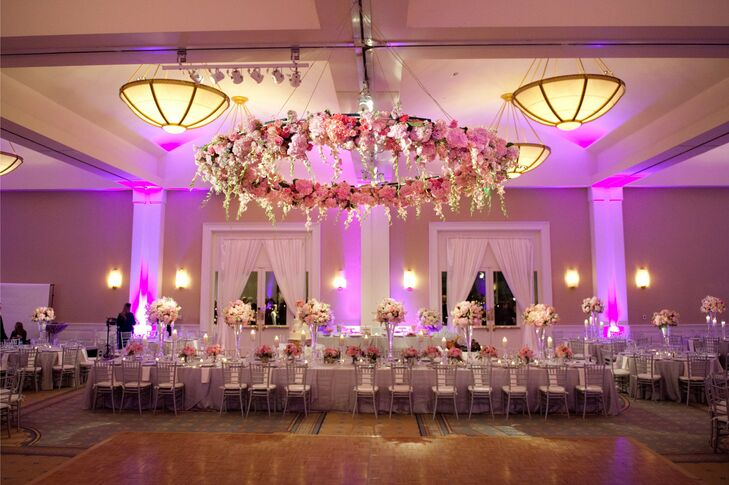For added romance and drama, the couple chose to hang a large floral halo over the dance floor.