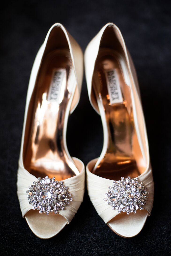"For an added dose of glam, Kelsey splurged on a pair of ivory Badgley Mischka heels from the Broadway Shoe Company in Fargo, North Dakota. ""I figured you only get married once, so I splurged,"" she says."