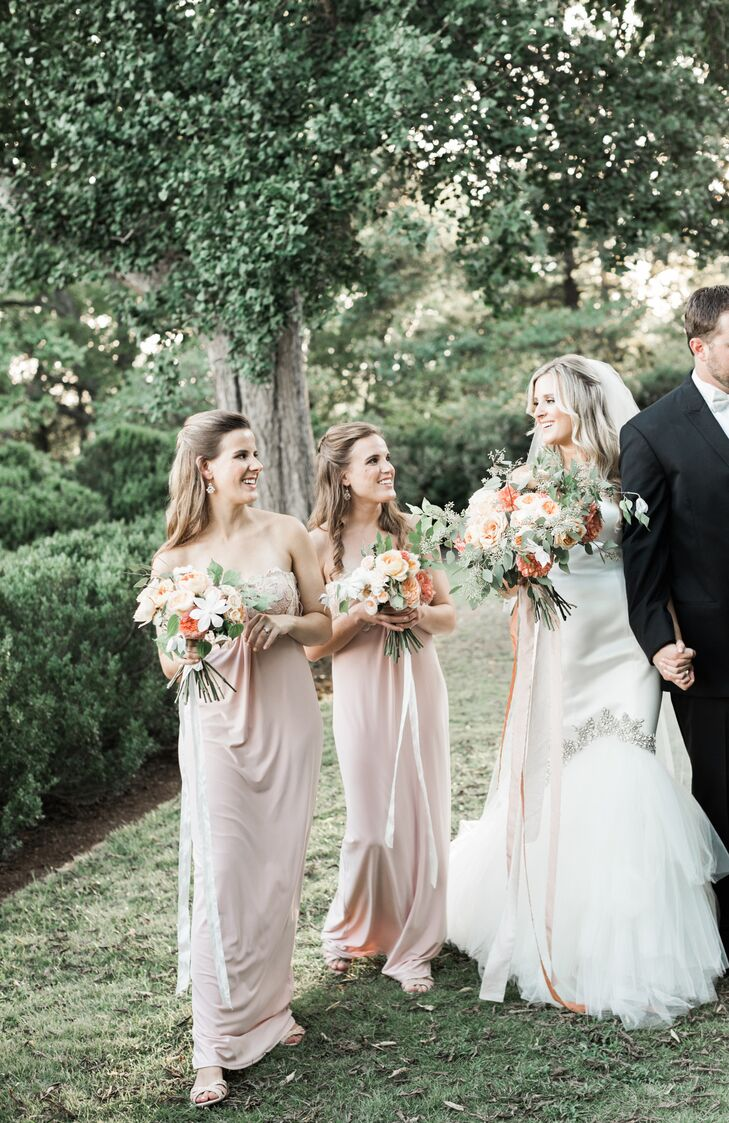 Bonnie's two bridesmaids, her sisters, wore blush-hued strapless gowns with a gold embellishment at the bustline.