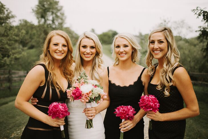 """All three bridesmaids wore black dresses in different styles that suited their body types, and held bright pink peony bouquets that added a pop of color. """"Looking back on my photos, I couldn't be happier with the last-minute decision,"""" Lexi says. """"Black is so classic, and I love how these girls just pop off the page."""""""