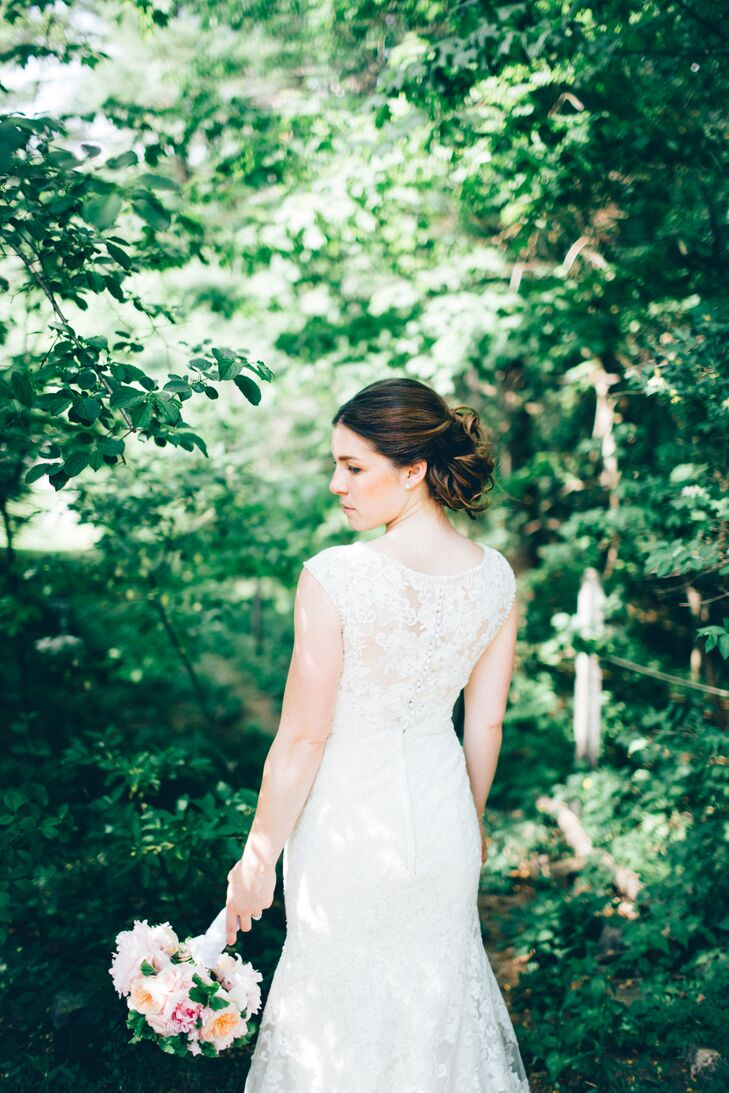 "Shaylyn's bridal look was all about classic romance. She spotted her trumpet-style Allure Bridals dress at Vows in Watertown, Massachusetts, and was instantly taken by the gown's delicate Alencon lace overlay, illusion neckline and elegant pearl accents along the neck and shoulder hems. ""It was a sample cut, and never went into production for the masses, so it is one-of-a-kind, which I loved,"" Shaylyn says."