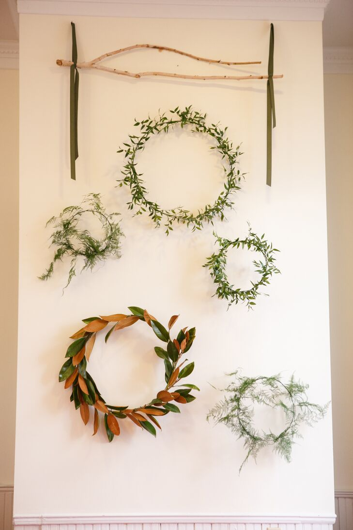 For Faith and Jackson's ceremony backdrop, Rosehip Flora created organic wreaths of winter greenery to evoke the season without detracting from the classic beauty of Hyde Park Presbyterian Church. A garland of olive branches decorated the chapel entrance.