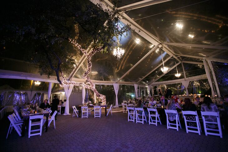 The reception took place under a clear tent in the courtyard at the Allan House in Austin, Texas, with crystal chandeliers overhead and a tree covered in string lights creating a soft glow. Having farm tables were a must for Faith, who wanted her reception to feel like a huge family dinner.
