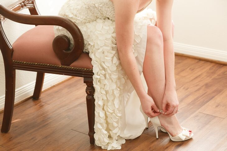 Faith's ivory bridal peep-toe heels matched the color of her dress perfectly. The bow embellishments continued the style of the petal appliques on the dress too.