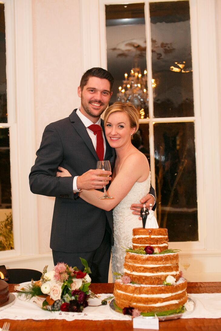 Faith and Jackson's cake embodied their style: It had a classic bride and groom cake topper, but the rustic naked cake style decorated with winter greenery and flowers conveyed their personal tastes.