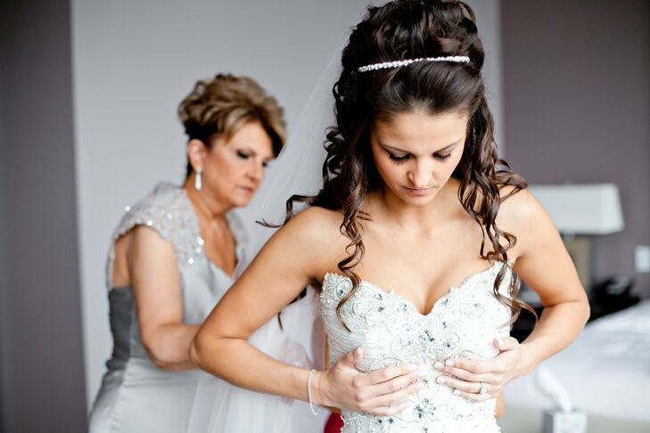 Teresa tried on several ball gowns before finding the strapless, trumpet-fit Stephen Yearick dress with plenty of sparkle and embellishment. She paired it with a sparkly headband and a cathedral-length veil in her curly half-up hairdo.