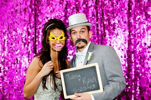 Bride and Groom with Chalkboard and Props in Pink Sequin Photo Booth