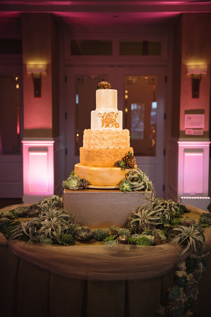 The custom five-tier cake had gold shimmering fondant with rose-gold detailing. The layers were based on the textured leather of one of Kelly's handbag collections, and the motifs were the same as those on their save-the-dates. The confection even had an entire tier of rosettes to match Kelly's dress.