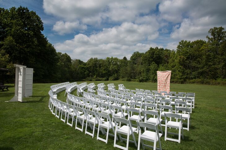 """Samantha and Ben's 150 wedding guests sat in white folding chairs as the couple said their """"I dos"""" at their outdoor ceremony at Cuyahoga Valley National Park."""