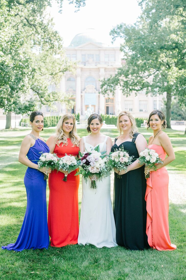 "Allison gave her bridesmaids only one rule to follow while picking out their dresses: their dresses must be floor-length. They ended up in a variety of styles and colors, ranging from cobalt blue to coral. ""They all looked like goddesses,"" Allison says."
