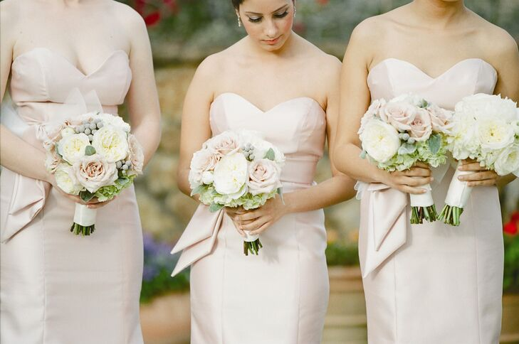 Jessica had all of her bridesmaids wear the same strapless trumpet-style gown in a soft shade of blush. The gowns were accented by large horsehair bows tied at the natural waist.