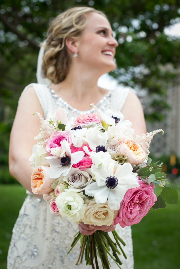 Kara's bouquet was a lovely arrangement of anemones, ranunculuses, garden roses, astilbe and roses.