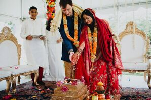 Interfaith Couple Participating in Traditional Hindu Ceremony