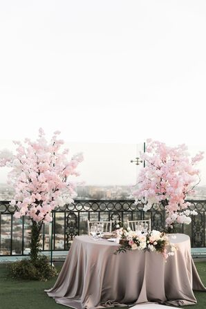 Sweetheart Table Flanked by Cherry Blossom Arrangements