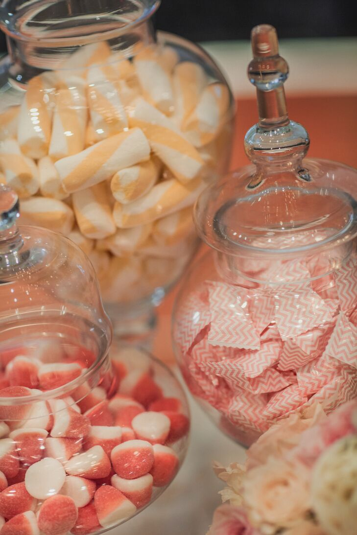 Colorful candies were displayed in clear jars for guests to enjoy during the reception.
