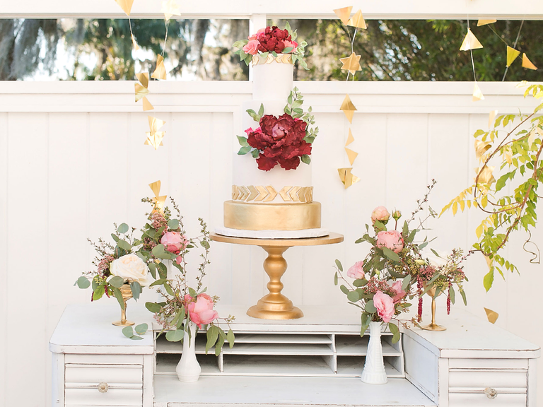 Boho gold and white wedding cake with sugar flower peony