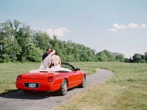 Couple Kissing in Chrystler Convertible in Field