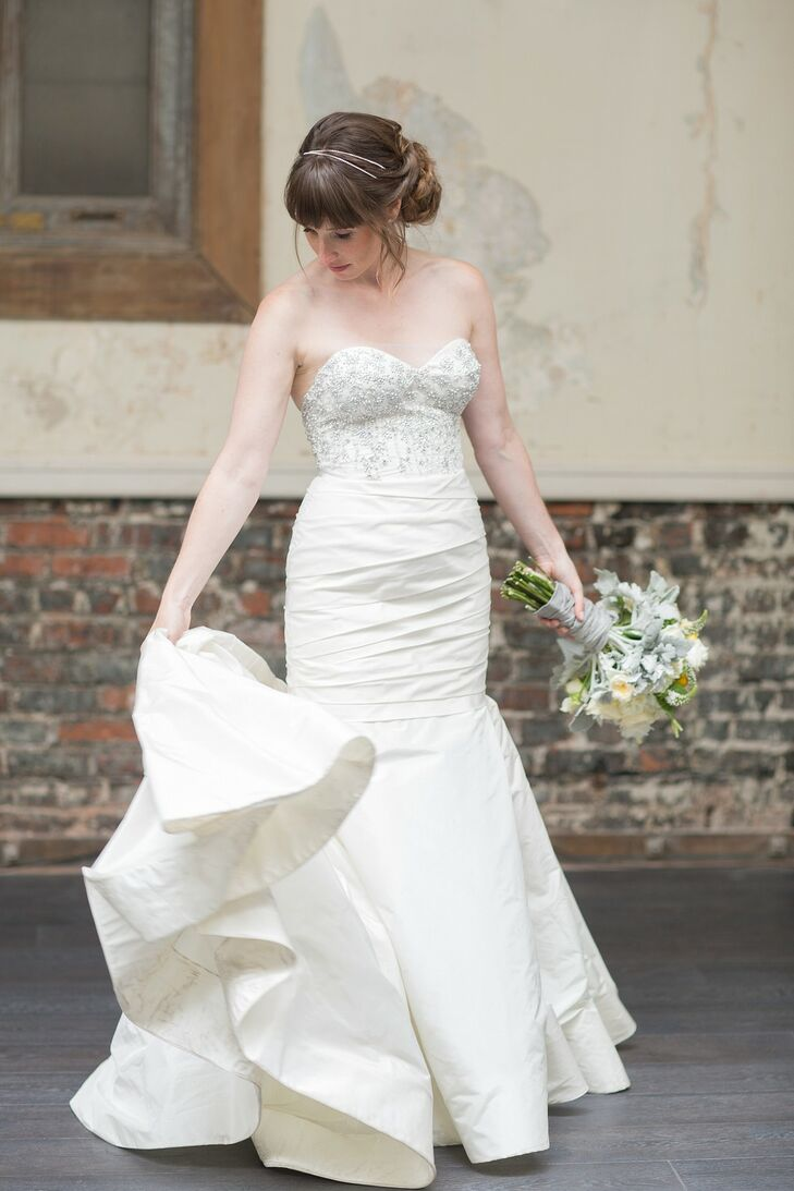 Emily wore a strapless ivory wedding dress with a fit and flare style, designed by Liancarlo.