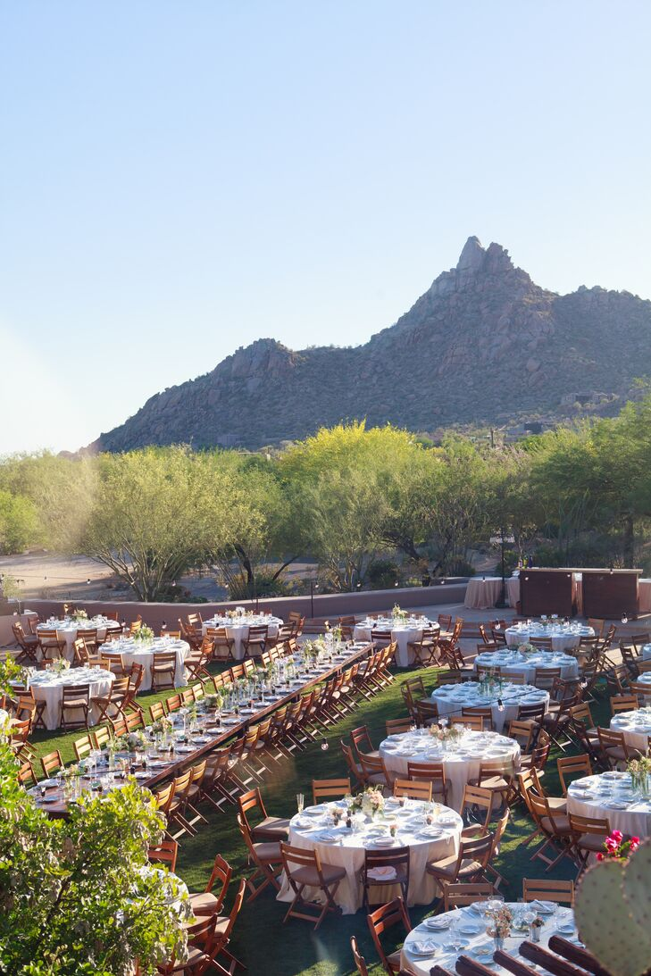 """After saying """"I do,"""" the pair whisked guests off to the Four Seasons for an unforgettable al fresco celebration. The majestic mountains beyond and the surrounding natural landscape provided a stunning backdrop for the evening."""