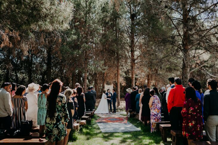 Bohemian Wedding Ceremony in Trees with Rug Aisle Runner