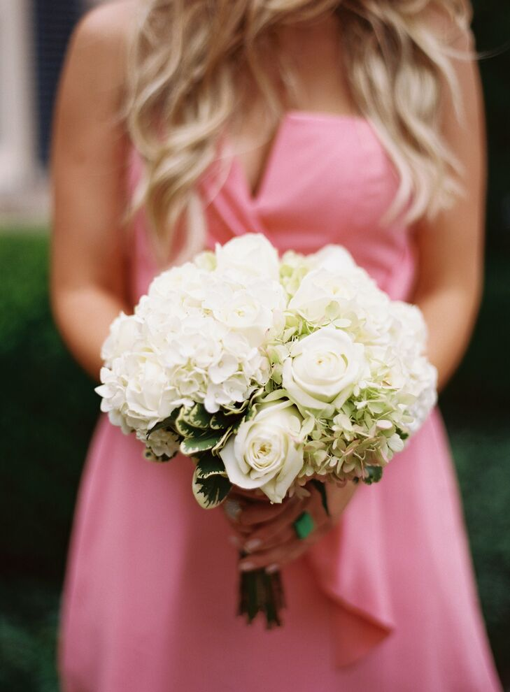 Caryn's bridesmaids carried bunches of white hydrangea and roses.