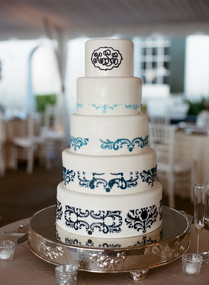 Kathryn and Cal's wedding cake was five tiers of white fondant decorated with blue piping in a damask style.