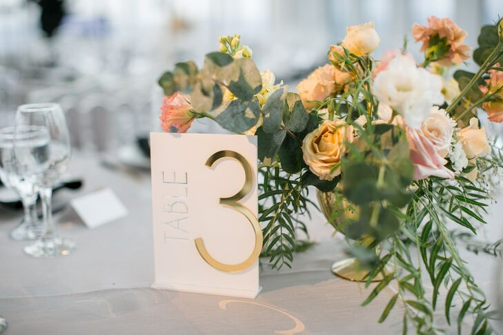 Elegant Table Numbers and Flower Centerpieces