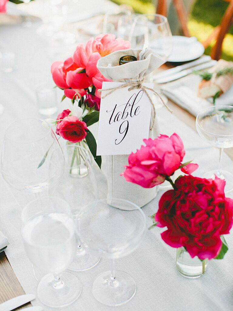 Vineyard wedding decor with covered wine bottles and peonies