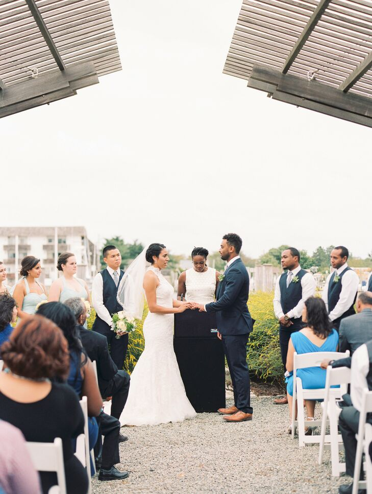 The only decorations for their ceremony included white chairs for guests to sit on. Beth and Aaron utilized the nature of the canal to outfit the space. The ceremony was officiated by Beth's high school Italian teacher.