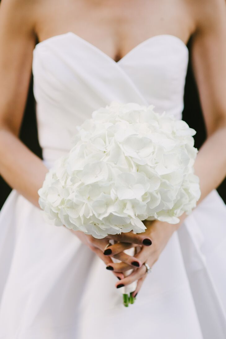 Jenny carried a simple bouquet of ivory hydrangeas, which are her favorite flowers.