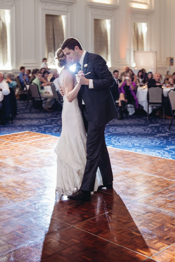 Erin and Alex shared their first dance as a married couple as family and friends watched on from their reception table seats.