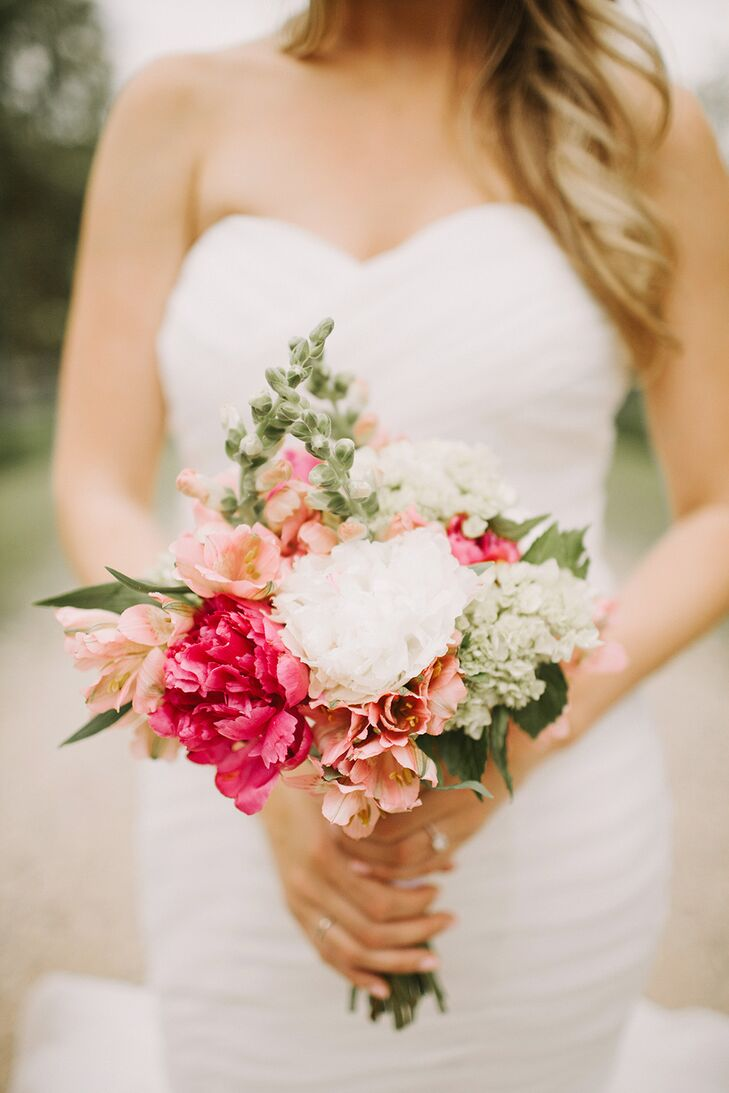 Lexi held a flower arrangement that embodied pure garden-inspired elegance! The bridal bouquet had peonies, lilies and stock in shades of pink and white.