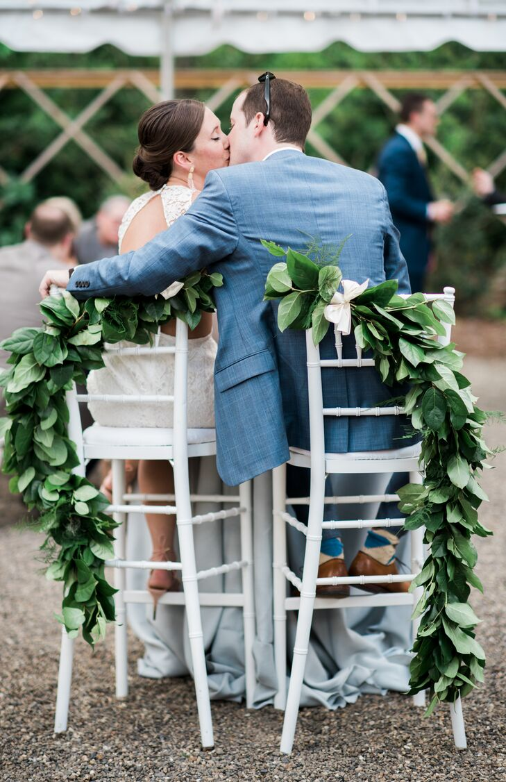 The newlyweds enjoyed their first meal as husband and wife together at a cozy high-top sweetheart table decorated with garlands.