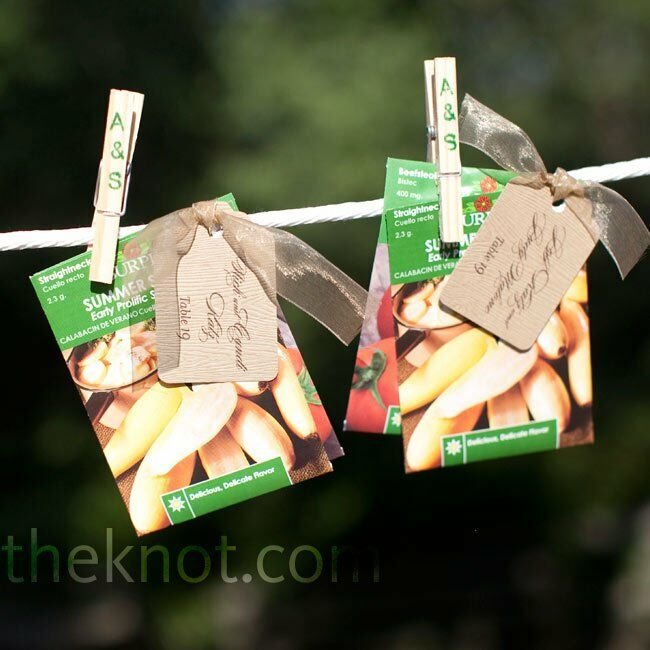 Seed packets were tied to the escort cards with ribbon and clipped to a clothesline.