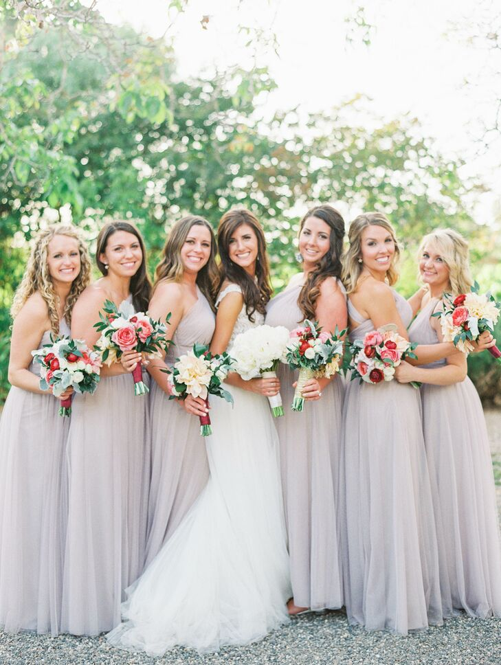 All the bridesmaids wore long neutral-colored dresses to match the natural garden look. The one-shoulder dresses fit all the women nicely, and they wore their hair down in an elegant fashion.