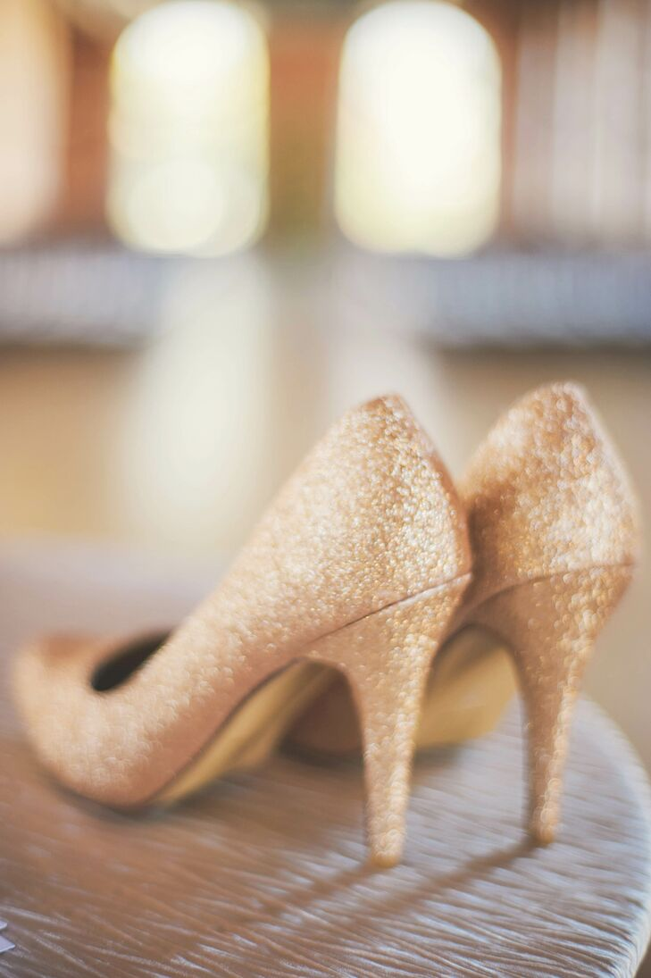 The bridesmaids all wore the small knee-length black Alfred Sung dress. Laura wanted them to be comfortable, so the dresses were all  one-shouldered fit-and-flare style. To add a little glam to their look, and so she bought each of them a pair of sparkly gold heels to go with their ensemble.