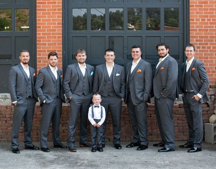 167dc51036f5 Each of the groomsmen wore dark suits with pocket squares of varying bright  colors.