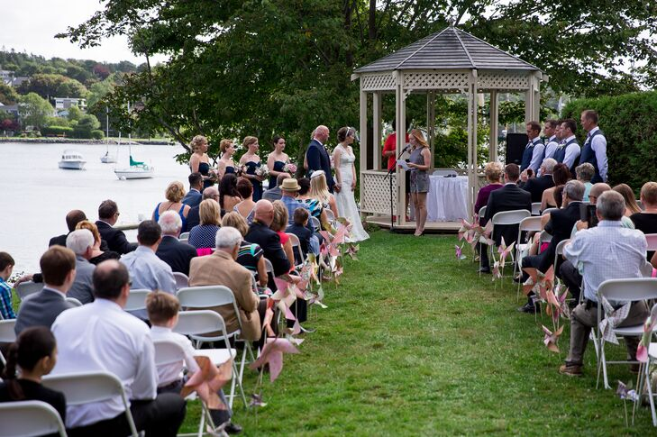 The couple exchanged vows outdoors, in front of a gorgeous gazebo, with an oceanside view.