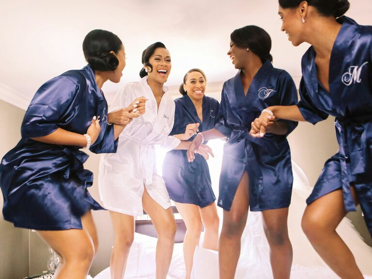 bride and bridesmaids in matching silk robes