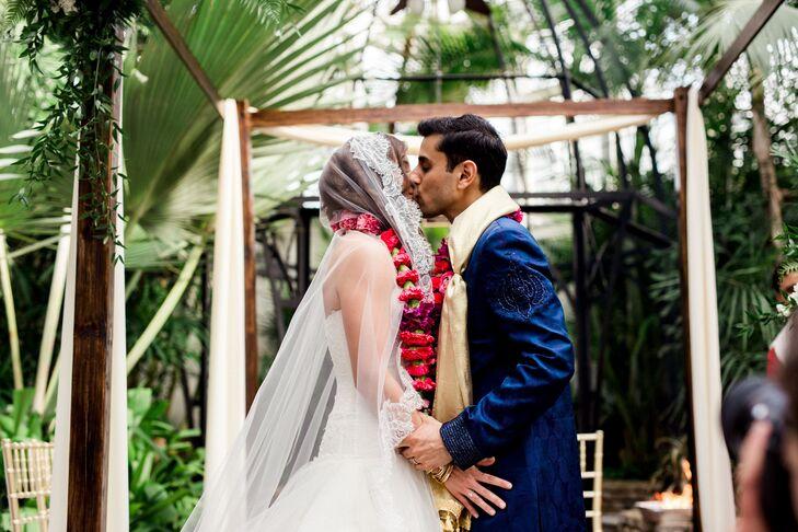 Couple with Flower Garlands Under a Wood Mandap
