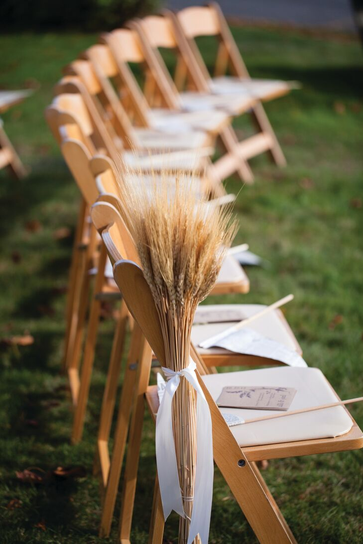Shocks of wheat were tied to the chairs along the aisle. Programs and newspaper pennants were placed atop each seat.