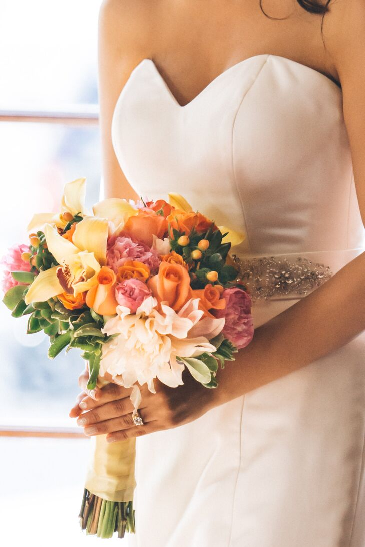 Jess carried a bouquet filled with white and pink peonies, yellow orchids and pink and orange and pink roses accented with hypericum berries.