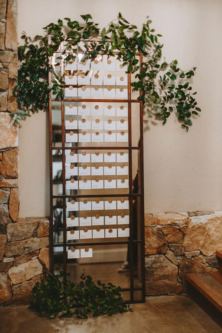 Modern, Rustic Escort Card Display with Mirrors and Leaves