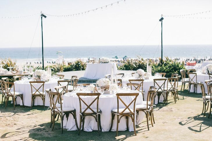 After the beach ceremony and a cocktail hour, guests headed to the nearby Monarch Bay Club in Dana Point, California, where there were white linen-covered tables topped with driftwood, candles and sea glass.