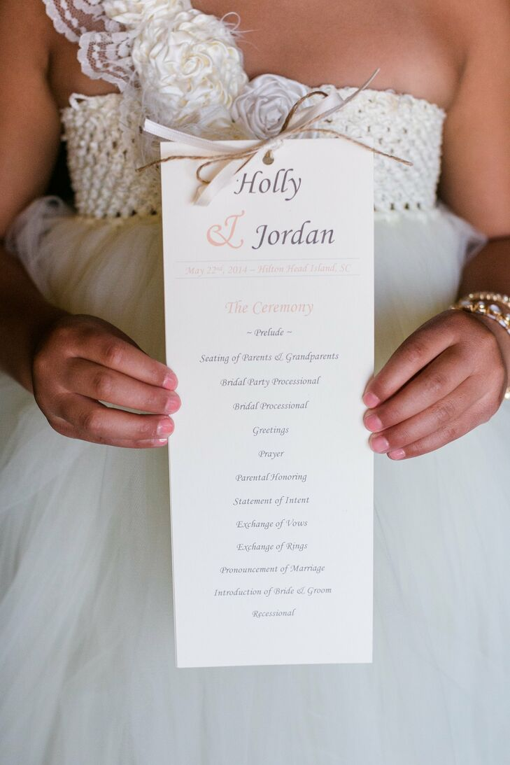 Holly handmade her programs, which featured a satin and twine ribbon at the top.