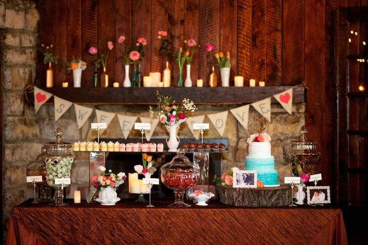 The rustic dessert table featured candy, cupcakes and a blue and white ombre cake.