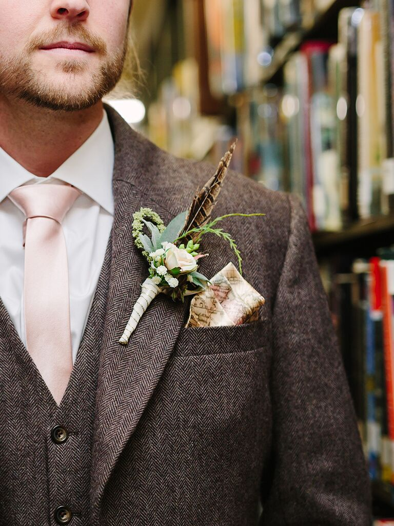 Rugged groom look with a map-themed pocket square